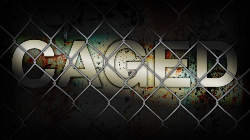 caged behind fence